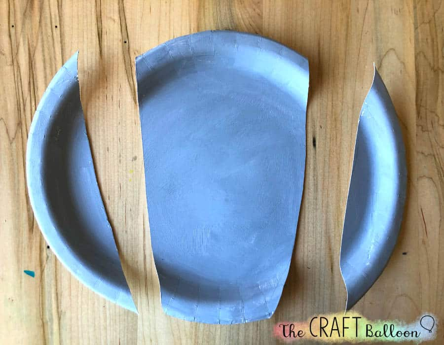 grey paper plate cut with two sides cut