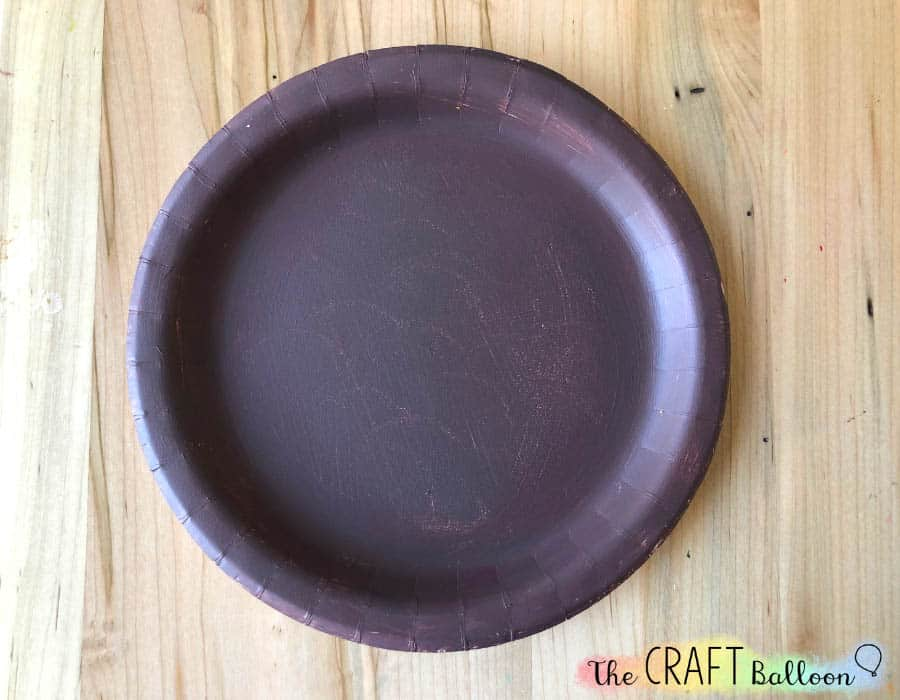 Paper plate painted brown