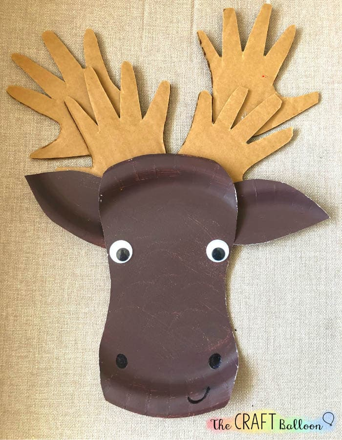 Paper plate moose face with handprint antlers