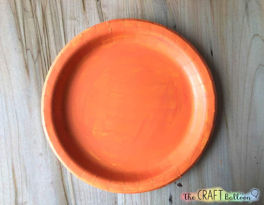 Paper plate painted oranage