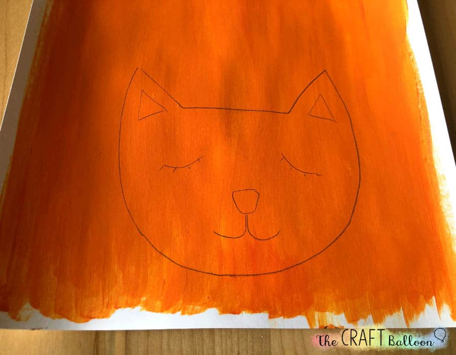 Cat face drawn on cardstock